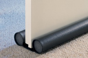 Black Draught Excluder Placed Under a Door