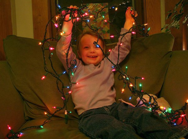 Kid With a String of Christmas Lights