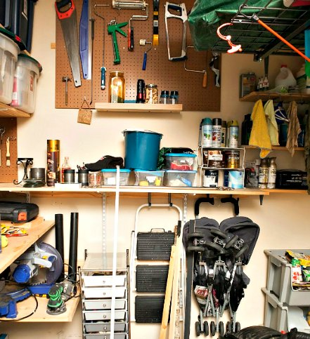 organized garage with categorized tools and similar