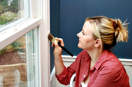Woman Repainting Windows